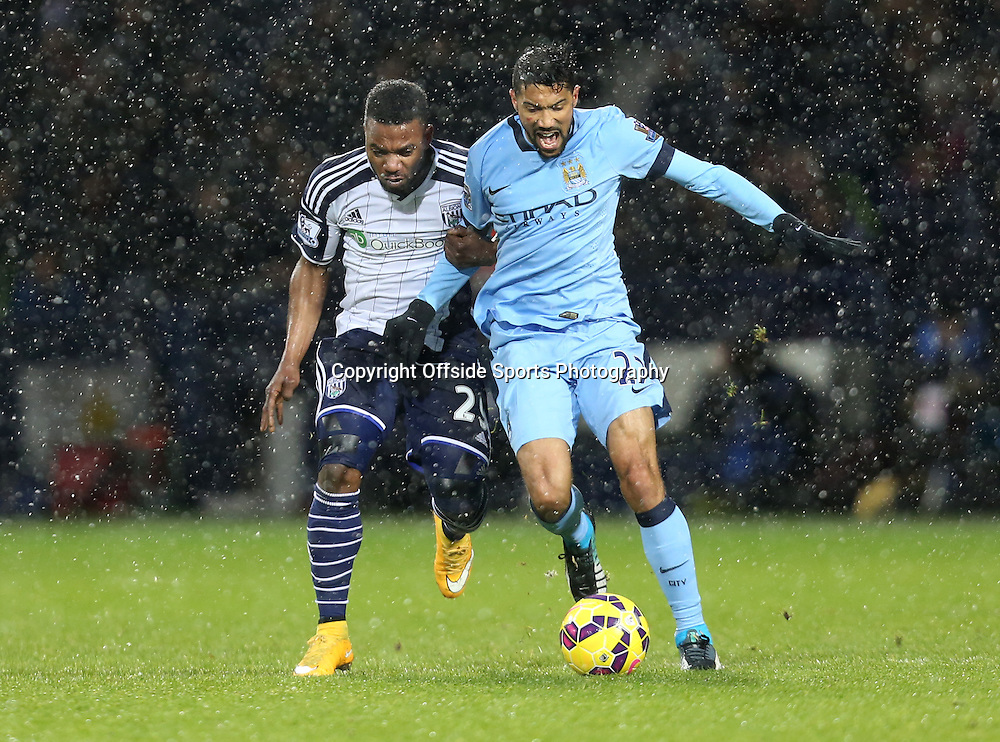 26th December 2014 - Barclays Premier League - West Bromwich Albion v Manchester City - Gael Clinchy of Manchester City battles with Stephane Sessegon of West Bromwich Albion - Photo: Paul Roberts / Offside.