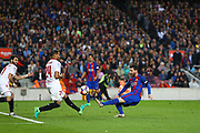 LIONEL MESSI of FC Barcelona kicks the ball under pressure from GABRIEL MERCADO of Sevilla FC during the Spanish championship Liga football match between FC Barcelona and Sevilla FC on April 5, 2017 at Camp Nou stadium in Barcelona, Spain. <br /> Photo Manuel Blondeau / AOP Press / ProSportsImages / DPPI