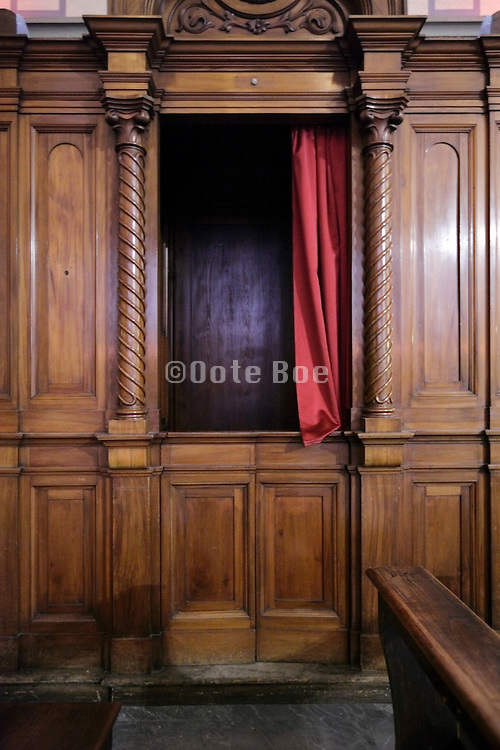 close up of a confession box with open curtain