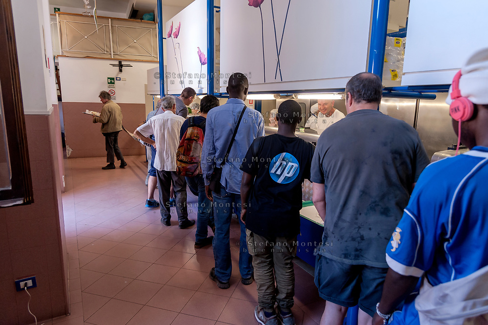 ROME, ITALY - AUGUST 15: Guests stand inline to the Caritas canteen at Colle Oppio in Rome  on the mid-August holiday on August 15, 2017 in Rome, Italy. Caritas canteen of Colle Oppio  provide about 500 meals a day for lunch.