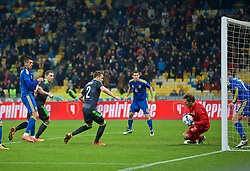 KIEV, UKRAINE - Easter Monday, March 28, 2016: Ukraine's goalkeeper Andriy Pyatov makes save from Wales's Sam Vokes during the International Friendly match at the NSK Olimpiyskyi Stadium. (Pic by David Rawcliffe/Propaganda)
