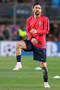Barcelona forward Lionel Messi (10) stretching in warm up during the Champions League quarter-final leg 2 of 2 match between Barcelona and Manchester United at Camp Nou, Barcelona, Spain on 16 April 2019.
