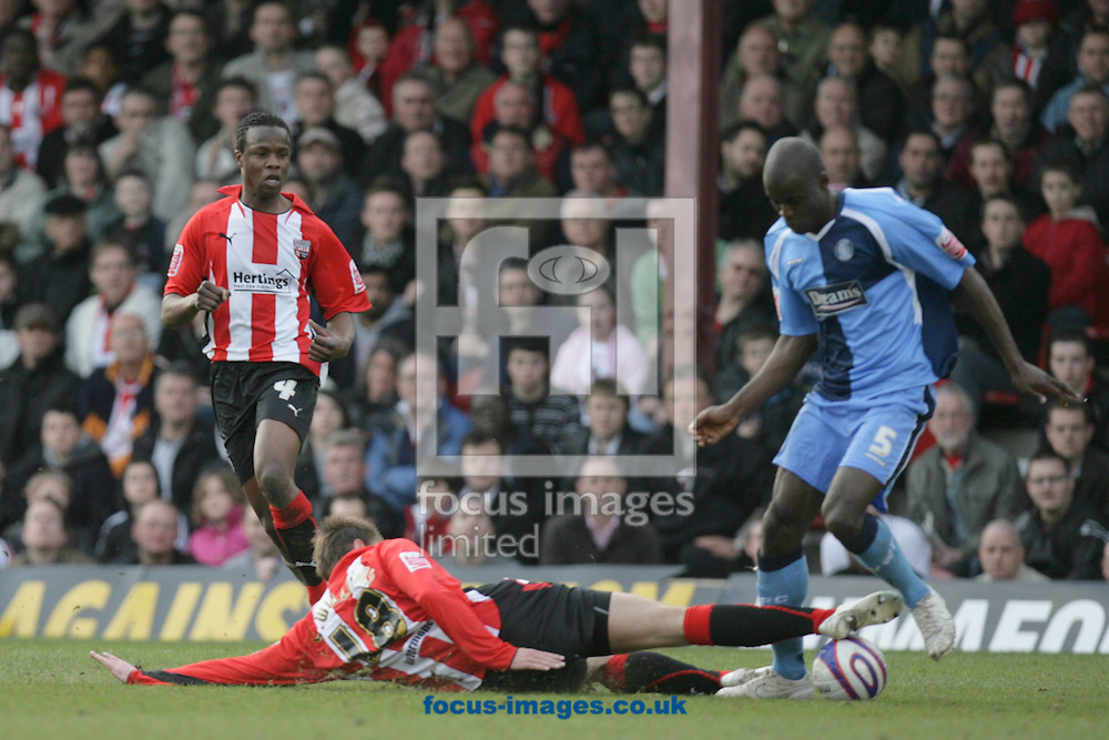 London - Saturday, March 14th, 2009: Marcus Bean (L) of Brentford looks on as Sam Williams tackles Will Antwi (R) of Wycombe Wanderers during the Coca Cola League Two match at Griffin Park, London. (Pic by Mark Chapman/Focus Images)