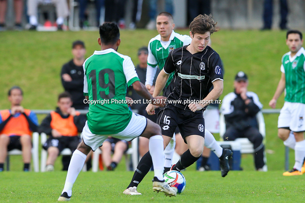 Waitakere City's Adyn Kettle looks for a way around Manukau City's Leo Berlim. ISPS Handa Chatham Cup Round 2, Waitakere City FC v Manukau City AFC, Fred Taylor Park, Whenuapai, Auckland, Monday 5th June 2017. Copyright Photo: David Joseph  / www.photosport.nz