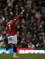 Photo: Paul Thomas.<br /> Manchester United v Wigan Athletic. The Barclays Premiership. 26/12/2006.<br /> <br /> Cristiano Ronaldo celebrates (L) his 1st goal for Man Utd.