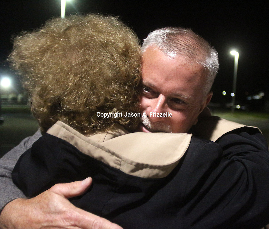 Candidate Gary Doetsch hugs Carolyn Thomas outside the Carolina Beach Recreation Center. (Jason A. Frizzelle)