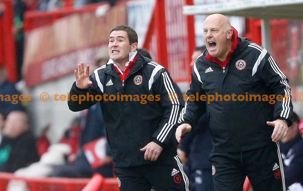 Sheffield United&rsquo;s Manager Nigel Clough [L and his assistant gesture to there players during the Sky Bet division on match between Crawley Town and Sheffield United at the Checkatrade.com Stadium in Crawley. February 27, 2015.<br /> James Boardman / TELEPHOTO IMAGES 07967642437
