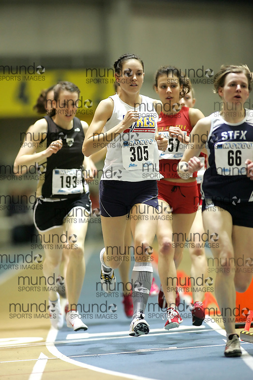 (Windsor, Ontario---12 March 2010) Claire Jean of University of Victoria   competes in the 3000m final at the 2010 Canadian Interuniversity Sport Track and Field Championships at the St. Denis Center. Photograph copyright Sean Burges/Mundo Sport Images. www.mundosportimages.com