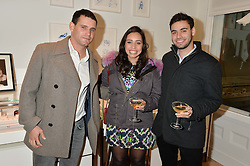 Left to right, ROY ZABLUDOWICZ, OLIVIA ZABLUDOWICZ and LIAM ZABLUDOWICZ at a private view of Stephen Webster's new White Kite collection held at his flagship store at 130 Mount Street, London on 24th November 2016.