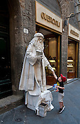 An actor portraying Michelangelo stands outside of a shop in Florence, Italy. (Sam Lucero photo)
