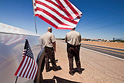 04 AUGUST 2010 -- GILBERT, AZ:  Maricopa County Deputies and Detention Officers wait for the Det Carlos Ledesma's cortege to pass at the funeral for Chandler police detective Carlos Ledesma Wednesday. Ledesma was killed during a shoot out with suspected drug dealers during an undercover operation in south Phoenix Wednesday July 28.   PHOTO BY JACK KURTZ