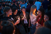 Students attend the vigil for slain German exchange student, Diren Dede, on May 2, 2014, at the Fort Missoula soccer field where Dede had played.
