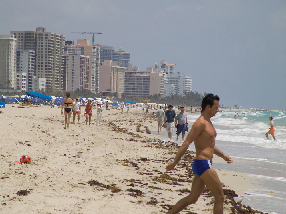 man walking towards the water for a swim Miami Beach USA