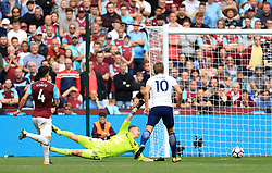 Tottenham Hotspur's Harry Kane (right) scores his side's second goal of the game during the Premier League match at the London Stadium.