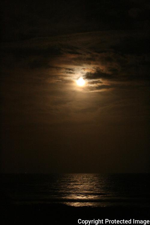 Full moon over a Jekyll Island beach. December night.