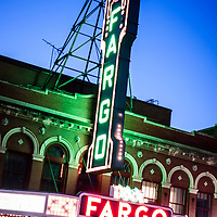 Photo of Fargo ND theater marquee sign at night. The Fargo Theatre was built in 1926 and is on the National Register of Historic Places. The Fargo Theatre is currently a popular venue for films, movies, concerts, plays and other live events. Photo is vertical and was taken in 2011.