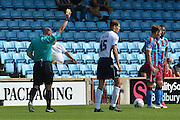 Sid Nelson receives yellow card during the Sky Bet League 1 match between Scunthorpe United and Millwall at Glanford Park, Scunthorpe, England on 22 August 2015. Photo by Ian Lyall.