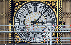© Licensed to London News Pictures. 12/10/2017. London, UK. A scaffolder (R) takes a photo from Elizabeth Tower, known as Big Ben at Parliament. Scaffolding will reach a height of 96 meters when completed - the work is part of a three-year programme to conserve the Great Clock, the Elizabeth Tower and Big Ben. London, UK. Photo credit: Peter Macdiarmid/LNP
