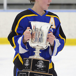 Staff photos by Tom Kelly IV<br /> East's Alexa Weiderhold (39) skates around with the cup following the Downingtown East vs Unionville girls Flyer's Cup Championship, Wednesday night March 19, 2014 at Ice Line in West Goshen.