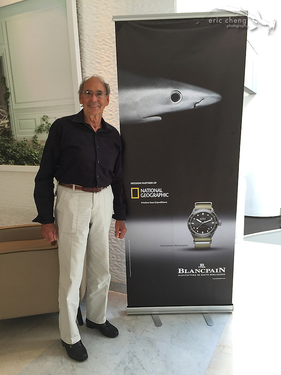 Ernie Brooks stands in front of his blue shark photo
