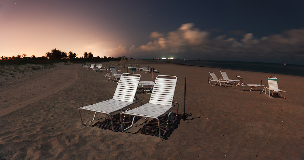 Lawn chairs line the shore of Key Biscayne outside of Miami, Florida.