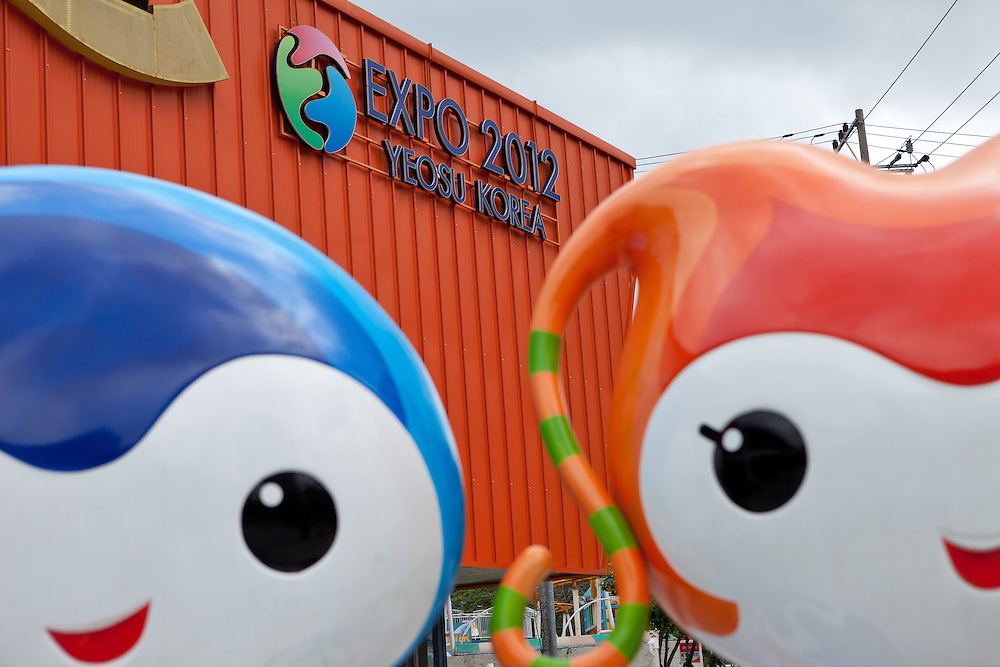 """Yeony and Suny"" - the official mascots of the Expo 2012 in front of the information center in the South Korean city. Yeosu will host the Expo 2012 exhibition  under the theme ""The Living Ocean and Coast"". Yeosu (Yeosu-si) is a city in South Jeolla Province. Old Yeosu City, which was founded in 1949, Yeocheon City, founded in 1986, and Yeocheon County were merged into a new city in 1998."