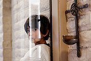 An altar server waits for the start of Mass with Holy Family Chaldean Catholic Mission at Our Lady Of The Valley Roman Catholic Church in Phoenix Aug. 23, 2015. (Nancy Wiechec for ONE magazine)