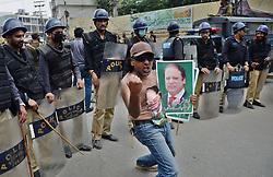 July 29, 2017 - Lahore, Punjab, Pakistan - Pakistani protesters celebrate the decision by the Supreme Court of Pakistan to disqualify PM Nawaz Sharif. (Credit Image: © Rana Sajid Hussain/Pacific Press via ZUMA Wire)