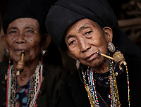 KYAING TONG, MYANMAR - CIRCA DECEMBER 2017: Portrait of elder women of the Wan Sai Akha Village in Kyaing Tong smoking.