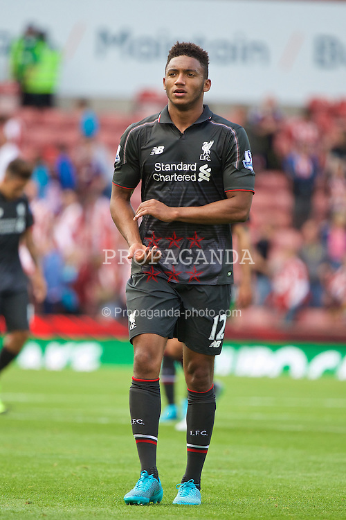 STOKE-ON-TRENT, ENGLAND - Sunday, August 9, 2015: Liverpool's Joe Gomez applauds the supporters after the 1-0 victory over Stoke City during the Premier League match at the Britannia Stadium. (Pic by David Rawcliffe/Propaganda)
