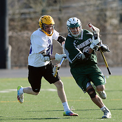 Staff photos by Tom Kelly IV<br /> Bonner-Prendie's Ronnie Shiler (9) runs with the ball as Upper Darby's Max Livingston (20) pursuits him during the Upper Darby at Bonner-Prendie boys lacrosse game on Monday, March 23, 2015.