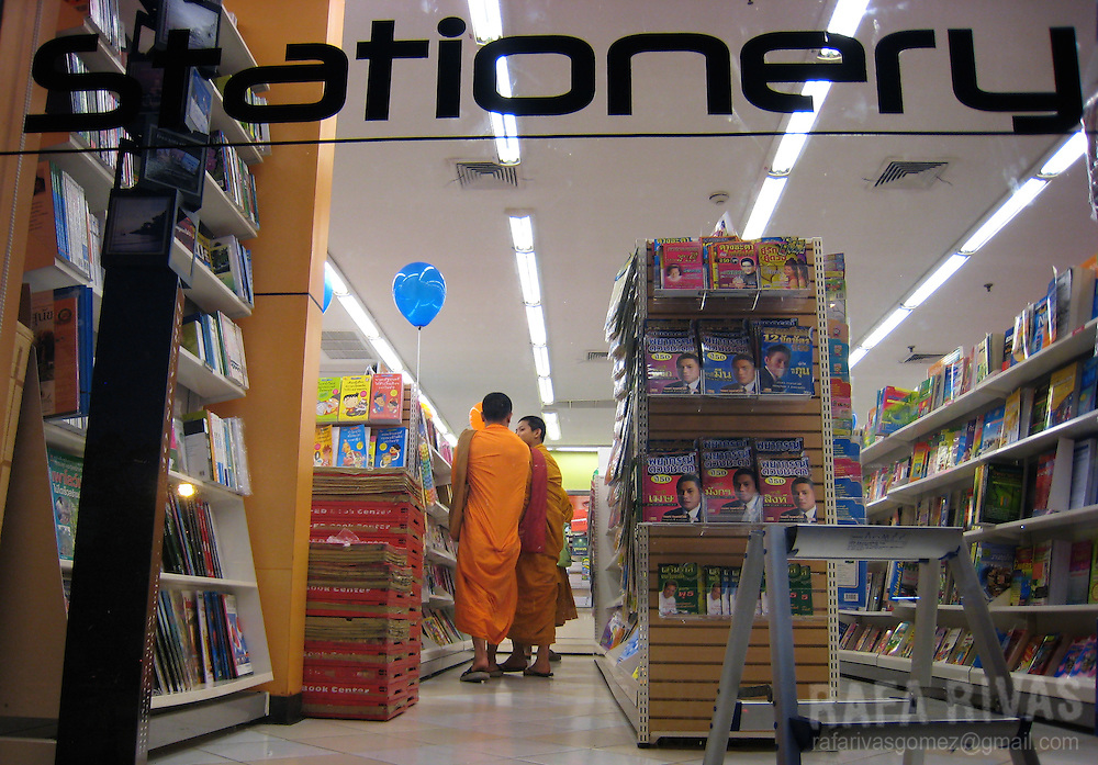 Buddhist monks buy at a stationery shop in Udon Thani, Thailand