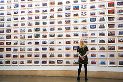 © Licensed to London News Pictures. 11/11/2019. London, UK. A staff member views the preview of S'Steve McQueen Year 3' exhibition at Tate Britain. An installation of over 3,000 class photographs on the walls of Tate Britain's Duveen Galleries, depicting more than 70,000 Year 3 pupils from London's primary schools by Turner Prize-winning artist and Oscar-winning filmmaker Steve McQueen. The exhibition opens on 12 November until 3 May 2020. Photo credit: Dinendra Haria/LNP