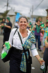 12 March 2016. New Orleans, Louisiana.<br /> Erin Ribka at the Irish Channel St Patrick's Day parade as the procession makes its way along Magazine Street.<br /> Photo©; Charlie Varley/varleypix.com