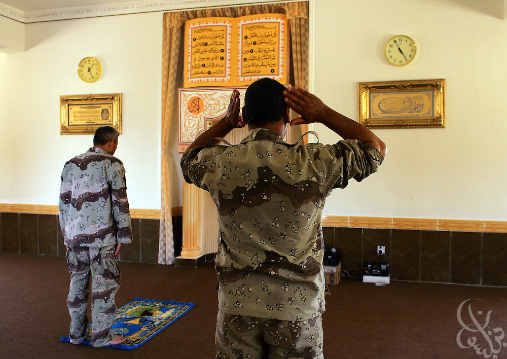 Iraqi Army Tenth Division, 4th Brigade soldiers attend afternoon prayers at a mosque on the brigade's Sparrow Hawk base outside al-Amarah, Iraq May 27, 2006.