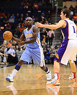 Nov. 12, 2012; Phoenix, AZ, USA; Denver Nuggets guard Ty Lawson (3) handles the ball against the Phoenix Suns guard Goran Dragic (1) during the first half at US Airways Center. Mandatory Credit: Jennifer Stewart-US PRESSWIRE..