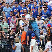 Fans try and catch a fly ball during the New York Mets Vs Cincinnati Reds MLB regular season baseball game at Citi Field, Queens, New York. USA. 28th June 2015. Photo Tim Clayton