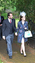 Hon.ALICE BEAUMONT and her fiance Richard Maxey at the wedding of Princess Florence von Preussen second daughter of Prince Nicholas von Preussen to the Hon.James Tollemache youngest son of the 5th Lord Tollemache held at the Church of St.Michael & All Angels, East Coker, Somerset on 10th May 2014.