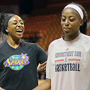 Sisters Chiney Ogwumike, (right), Connecticut Sun and Nneka Ogwumike, Los Angeles Sparks during a television interview before playing against each other for the fist time in the WNBA during the Connecticut Sun Vs Los Angeles Sparks WNBA regular season game at Mohegan Sun Arena, Uncasville, Connecticut, USA. 3rd July 2014. Photo Tim Clayton