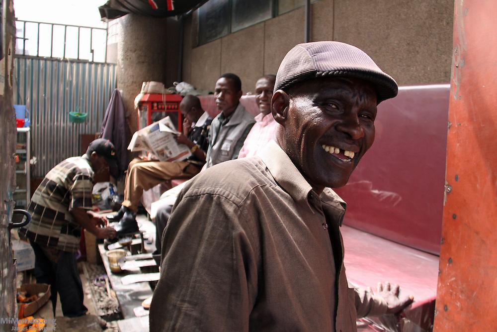Shoe shine stand just outside Marikiti, Nairobi's largest produce wholesale market. The Kiswahili word Marikiti derives from the English word Market.