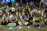 12 SEPTEMBER 2003 - CANCUN, QUINTANA ROO, MEXICO: Mourners and anti-globalization protestors participate in a memorial service for Lee Kyung-hae Friday. Kyung-hae, a Korean anti-globalization protestor, committed suicide Wednesday during an anti-globalization protest in Cancun, Mexico. A shrine honoring Kyung-hae has been built at the spot where he died. Thousands of anti-globalization protestors have come to Cancun to try to disrupt the 5th Ministerial meeting of the World Trade Organization. The protestors have been restricted to downtown Cancun, while the WTO is meeting 10 miles away in the Cancun tourist zone. PHOTO BY JACK KURTZ