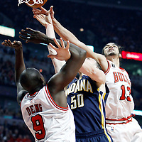 CHICAGO, IL - APR 18: Joakim Noah #13 of the Chicago Bulls blocks Tyler Hansbrough #50 of the Indiana Pacers during game 2 of the Eastern Conference First Round at the United Center on April 18, 2011 in Chicago, IL. NOTE TO USER: User expressly acknowledges and agrees that, by downloading and or using this photograph, User is consenting to the terms and conditions of the Getty Images License Agreement. Mandatory Credit: 2011 NBAE (Photo by Chris Elise/NBAE via Getty Images)