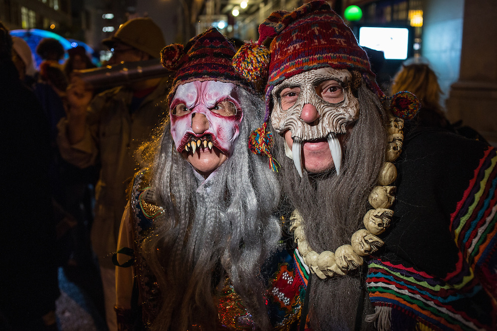 New York, NY, October 31, 2013. A couple wearing ghoulish masks in New York's Greenwich Village Halloween Parade.
