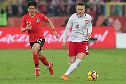 March 27, 2018 - Chorzow, Poland - Chang-hoon Kwon (KOR) vies Piotr Zielinski of Poland  during the international friendly soccer match between Poland and South Korea national football teams, at the Silesian Stadium in Chorzow, Poland on 27 March 2018. (Credit Image: © Foto Olimpik/NurPhoto via ZUMA Press)
