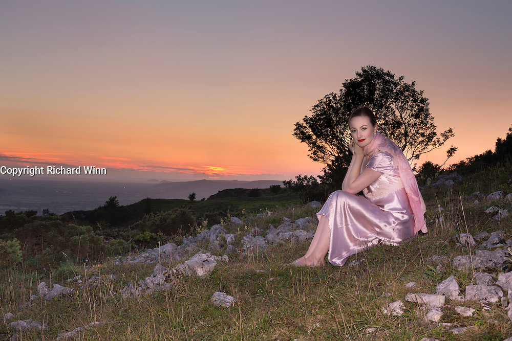 Woman dressed in 1940's style nightwear at dusk on Draycott Sleights, part of the Medip Hills.