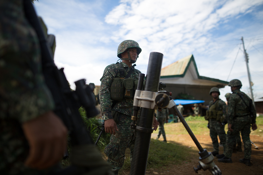MARAWI, PHILIPPINES - JUNE 9: Philippine marines fired a mortar as they attack remaining Islamist rebels during a heavy fight in Marawi, southern Philippines on June 9, 2017. Philippine military jets fired rockets at militant positions on Friday as soldiers fought to wrest control of the southern city from gunmen linked to the Islamic State group. (Photo: Richard Atrero de Guzman/NUR Photo)