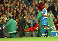 Photo: Back Page Images. 30/10/2004.<br /> Barclays Premiership. Blackburn Rovers v Liverpool. Ewood Park.<br /> Rafa Benitez looks concerned for Djibril Cisse as he is taken from the pitch on a stretcher