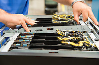 Cropped image of male technician examining computer card slots in electronics industry