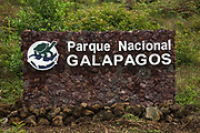 Galapagos National Park Sign.<br /> Isabela Island, GALAPAGOS ISLANDS<br /> ECUADOR.  South America