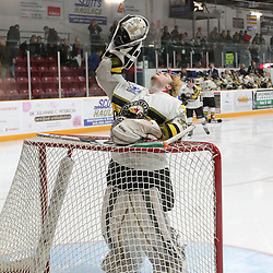 TRENTON, ON  - MAY 5,  2017: Canadian Junior Hockey League, Central Canadian Jr. &quot;A&quot; Championship. The Dudley Hewitt Cup. Game 7 between Georgetown Raiders and the Powassan Voodoos.  Nate McDonald #33 of the Powassan Voodoos gets prepared for the game.<br /> (Photo by Tim Bates / OJHL Images)